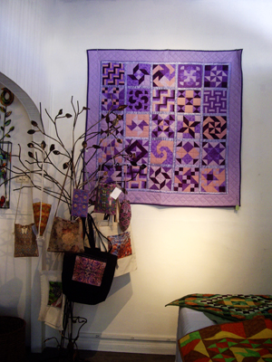 Carolyn Earls' quilts; Heidi Rand's tote bags